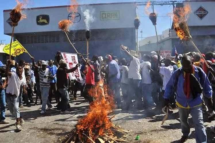 La imagen tiene un atributo ALT vacío; su nombre de archivo es Protestas-Haiti.jpg